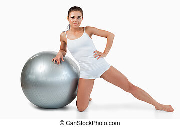 Woman working out with a ball