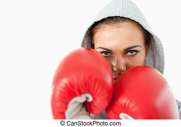 Female boxer with hoodie sweater on