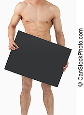 Atletic male body holding banner in his hands - Sporty male...