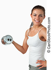 Portrait of a smiling woman working out against a white...