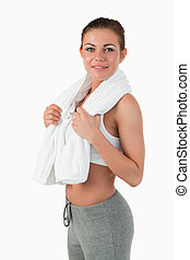 Side view of sportswoman with towel around her neck