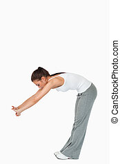 Young woman doing her stretches