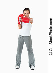 Female boxer striking with her left