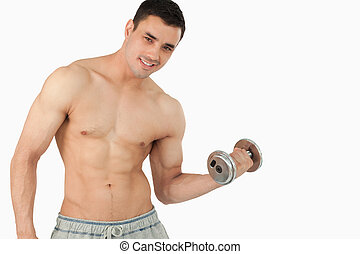Young man lifting weight against a white background
