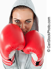 Female boxer wearing a hoodie sweater