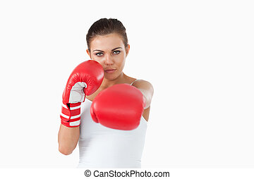 Young female boxer attacking with her left