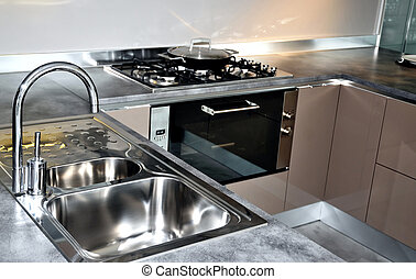 Stainless steel kitchen faucet and sink. Modern kitchen...