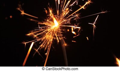 Sparkler - Burning sparkler on a black background
