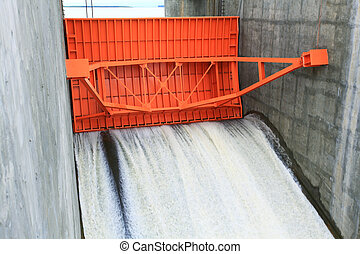 red water gate - close up of Water gate of Dam in Thailand
