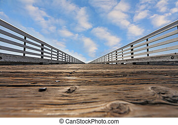 Wooden pier with a handrail on Pacific coast - Wooden pier...