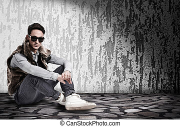 Loneliness - conceptual photo of young male sittin in a dark...