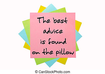 "text "" The best advice is found on the pillow "" written by hand font on bunch of colored sticky notes"