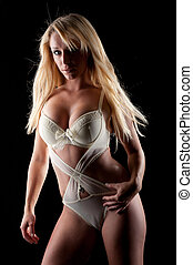 Sexy bolnd woman on lingerie - Sexy blond woman on a beije...