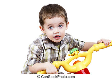 Little guy on a bike - Cute little boy playing by riding a...