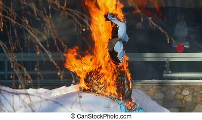 Farewell to winter in Russia. Burning effigies of Carnival