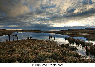 A remote fen on the Isle of Skye in the Outer Hebrides of Scotland, at sunrise
