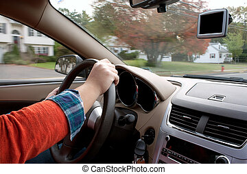 Person Driving a Car - A woman holds the steering wheel of a...