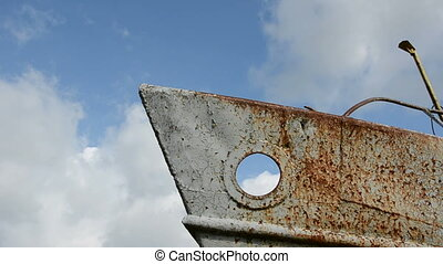 old rusted ship fragment and sky clouds fly