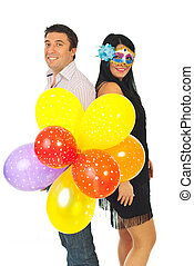 Happy party couple with balloons