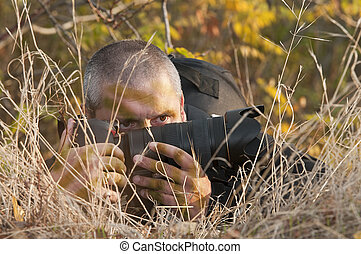 Camouflaged photographer - Photojournalist working in the...
