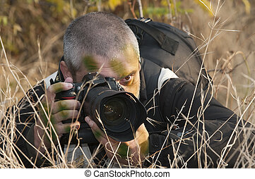 Camouflaged war photojournalist. - Photojournalist working...