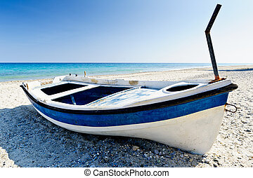 Colourful dinghy, beach resort - Old dinghy boat aground....