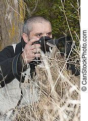 Photographer in a wild environment - Photojournalist working...