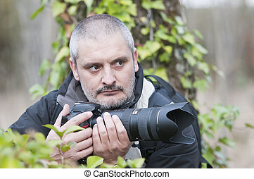 War photojournalist in a wild jungle - Photojournalist...