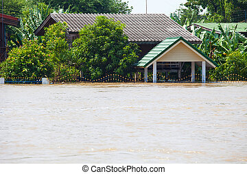flood waters overtake a house