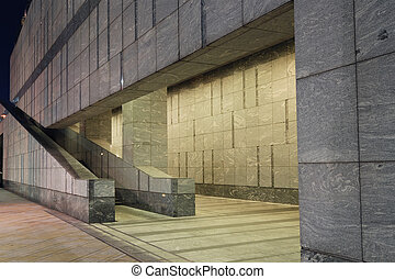modern architecture with stairs pavement, gray wall with...