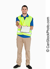 Smiling male in safety jacket handing his notes over