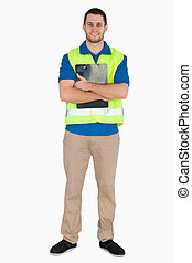 Smiling male in safety jacket holding his notes