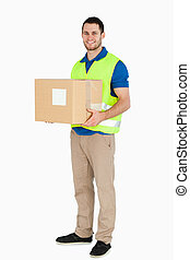 Smiling young delivery man holding a parcel