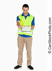 Smiling male in safety jacket passing his notes over