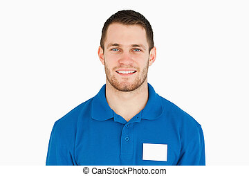 Smiling young sales assistant against a white background