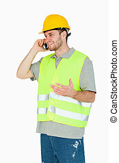 Smiling young construction worker discussing on the...
