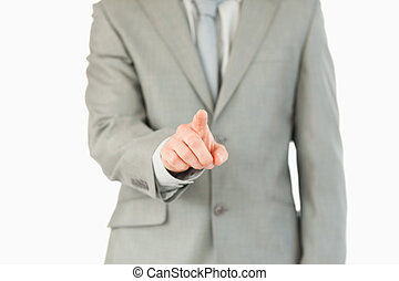 Businessman's finger activating futuristic touchscreen...