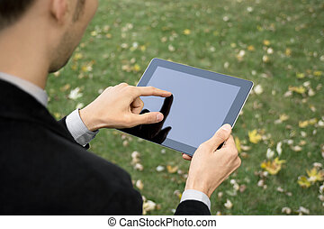 Businessman Working With Tablet PC - Businessman outdoors...
