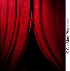 red theater curtain with soft lighting over black