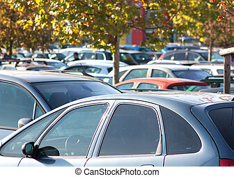Supermarket car park full of cars, evocation of...