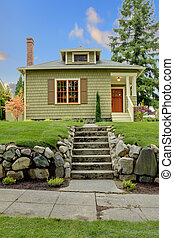 Craftsman green cute house exterior front.