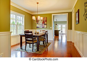 Green craftsman large dining room with cherry floor.