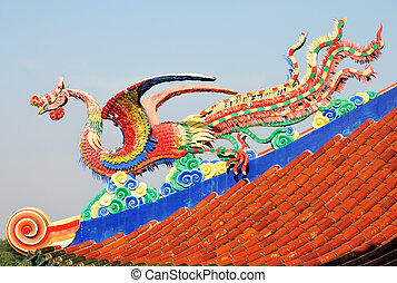 A legend Chinese sea bird sculpture on the roof with blue...