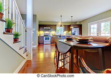 Large room with kitchen, dining and staircase