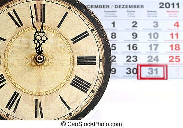 Old colck with calendar - one minute into the New Year, one...