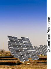 Modern solar power plant in the sunny plain - Solar panels...