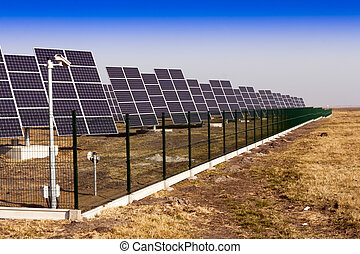 Solar panels installed on the field - Modern solar power...