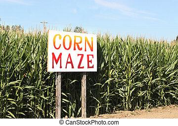 Corn Maze sign on autumn cornfield