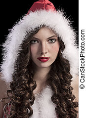 gorgeous young girl with a santa hood - beauty close up of a...