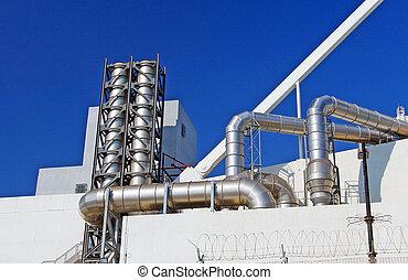 Industrial pipelines in blue sky